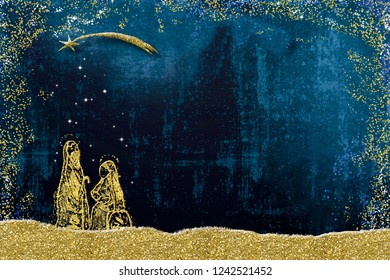 Abstract  Christmas Nativity Scene, Holy Family greetings cards. Abstract freehand drawing of  Holy Family with golden glitter on blue  paper background with copy space for message.