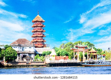 Abstract crystal effect  background,   Chinese temple style in sunny day, bangkok Thailand.  panorama view with blue sky, trees, river and building, landmark in thailand near river side.