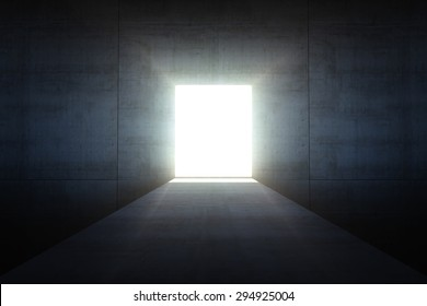 Abstract dark concrete interior with glowing doorway and light coming in.