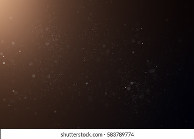 Abstract Dust Particle Background with Light Leak. Narrow Depth of Field.
