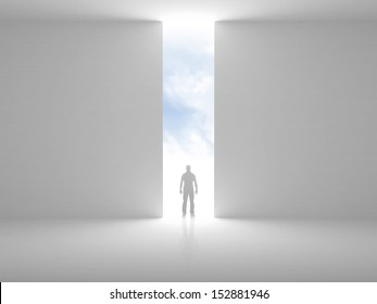 Abstract empty interior with opening in the wall and a man standing in the light