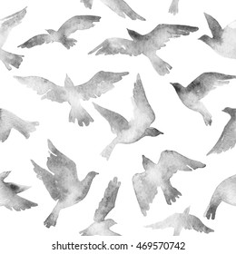 Abstract flying bird flock with watercolor texture on white background. Birds silhouettes seamless pattern. Hand painted animal illustration