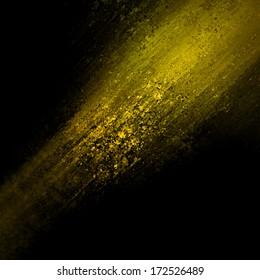 abstract gold background design, rough black border with gold streak or stream of bright light across dark contrasting black background, unique web design background or elegant brochure layout space
