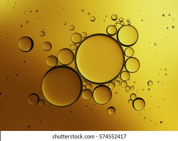 Abstract gold background. Oil Bubbles Isolated on White Background . Collagen Emulsion in Water. Gold Serum Droplets.