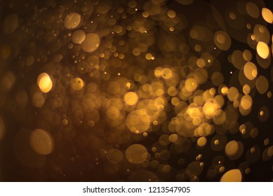 abstract gold background with soft blur bokeh light effect