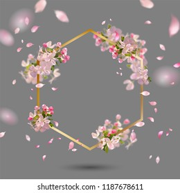 Abstract golden frame with spring flowers. Spring cherry blossom with falling petals and blurred transparent elements