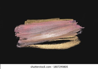 Abstract golden and pink hand painted stains on black background for your design