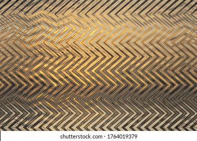 Abstraktes goldenes Zickzackmuster mit Wellen. Künstlerische Bildbearbeitung erstellt durch Foto von Meeresaufgang Sonne. Schönes mehrfarbiges Muster für jedes Dekor oder Design in goldenen Tönen. Hintergrundbild