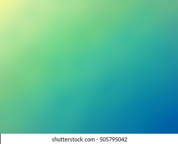 Abstract gradient green blue yellow colored blurred background.