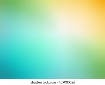 Abstract gradient orange teal green colored blurred background.