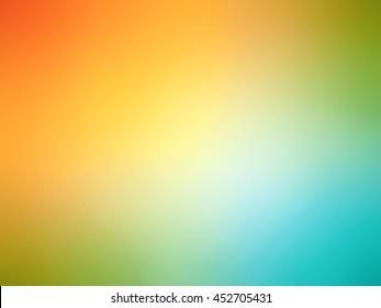 Abstract gradient rainbow orange yellow teal blue blurred background.