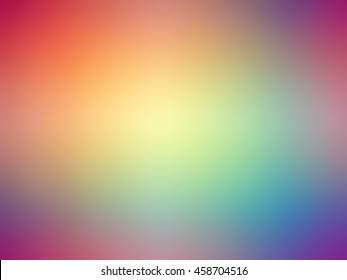 Abstract gradient rainbow red purple blue yellow green colored blurred background.