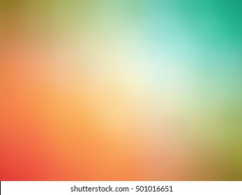 Abstract gradient rainbow ryellow orange teal colored blurred background.