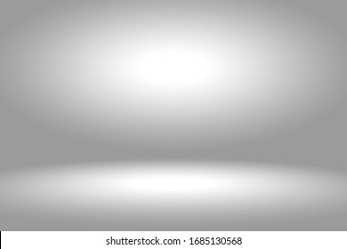 Abstract gray gradient spotlight room texture background.  Studio backdrop wallpaper light room wall white and empty space.