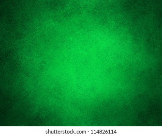 abstract green background or Christmas background with bright center spotlight and black vignette border frame with vintage grunge background texture green paper layout design colorful holiday art