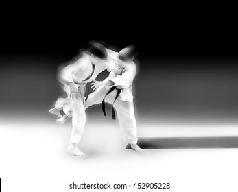 abstract image. athletes compete in the battles in the ring mat Judo Karate Sambo. The dramatic moment of battle punches