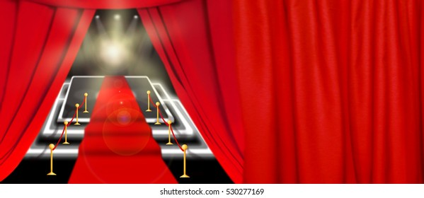 Abstract image. Red carpet with stairs between two rope barriers and flash light. Scene illuminated by a spotlight
