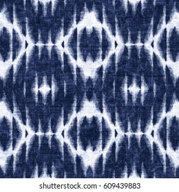 Abstract indigo dyed ornament textured background. Seamless pattern.