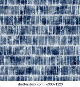 Abstract indigo tie-dyed grid motif. Seamless pattern.