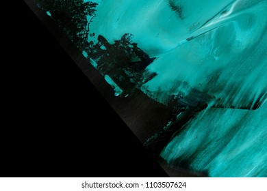 Abstract ink background. Marble style. Blue neon paint stroke texture on black paper. Wallpaper for web and game design. Grunge mud art. Macro image of pen juice. Dark Smear.