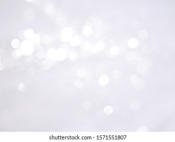 Abstract light bokeh like falling snow. Winter background.