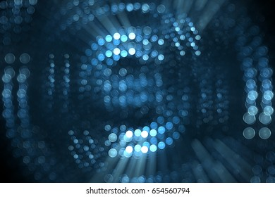 Abstract light emitting circles blue background