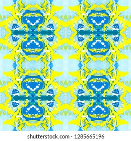Abstract marbling, ebru, ethnic seamless pattern, background - waves and splashes of blue and yellow colors. Colorful kaleidoscope ebru, marbling seamless pattern to be used as an abstract background