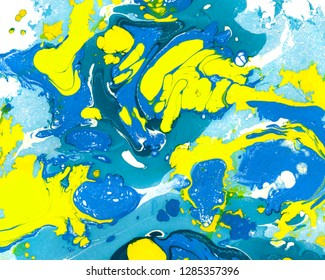 Abstract marbling, ebru style background with waves and splashes of blue and yellow colors. Colorful handmade ebru, marbling illustration for abstract background, backdrop design