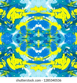 Abstract marbling, ebru style seamless pattern, background with waves and splashes of blue and yellow colors. Colorful handmade ebru, marbling seamless pattern to be used as an abstract background