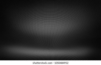 Abstract modern black carbon fiber material design for background, wallpaper, graphic design. Kevlar textured studio interior.