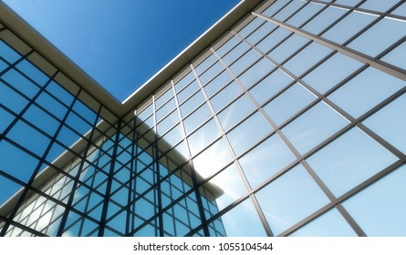 Abstract modern building in 3d. Glass and steel facade with reflections.