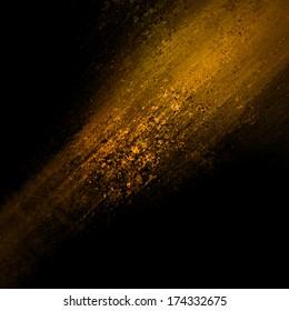 abstract orange copper background design, rough black border with gold streak or stream of bright light on dark contrast black background, unique web design background, elegant brochure layout space