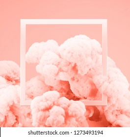 Abstract pastel Living Coral color paint smoke or explosion with pastel pink background. Fluid composition with copy space. Minimal natural luxury