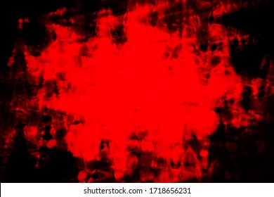 An abstract red grunge splattered blob background image.