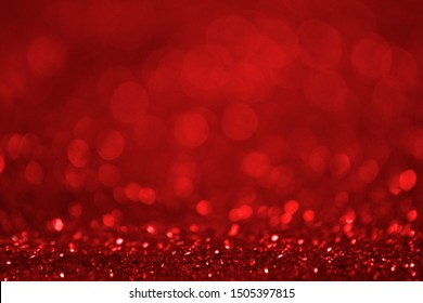 Abstract Red Shiny De-focused Particles Background