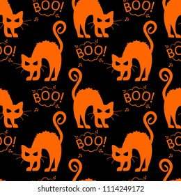 Abstract seamless halloween cat pattern for girls or boys. Creative pattern with cat, cloud boo, halloween. Funny halloween cat pattern for textile and fabric. Fashion style. Colorful picture.