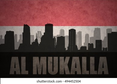 abstract silhouette of the city with text Al Mukalla at the vintage yemen flag background