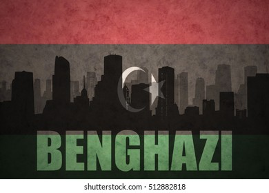 abstract silhouette of the city with text Benghazi at the vintage libyan flag background