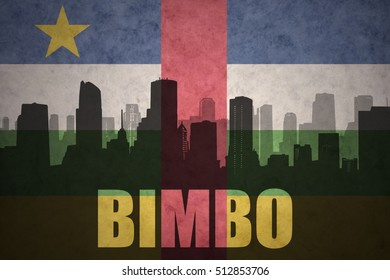 abstract silhouette of the city with text Bimbo at the vintage central african republic flag background