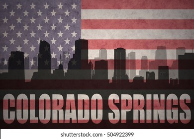 abstract silhouette of the city with text Colorado Springs at the vintage american flag background