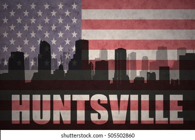 abstract silhouette of the city with text Huntsville at the vintage american flag background