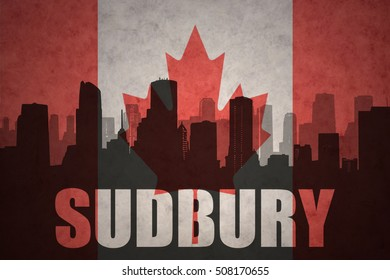 abstract silhouette of the city with text Sudbury at the vintage canadian flag background