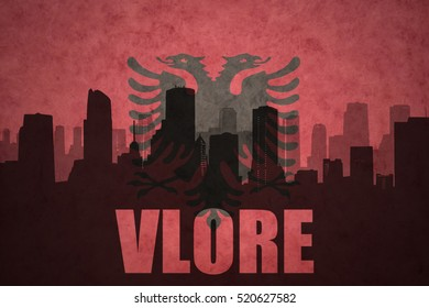 abstract silhouette of the city with text Vlore at the vintage albanian flag background