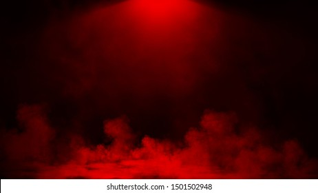 Abstract smoke spotlgith steam moves on a red background . The concept of aromatherapy.