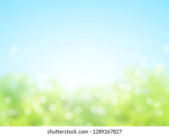 Abstract sunny blur spring background of green and blue colors