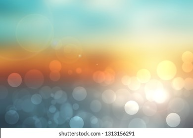 Abstract sunset illustration. Abstract evening or sunset mood background texture with orange and pastel colored bokeh lights and blue sky. Beautiful sunset.