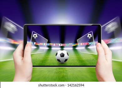 Abstract technology background - tablet pc, computer in hands, soccer ball, sports game online, soccer online, augmented reality