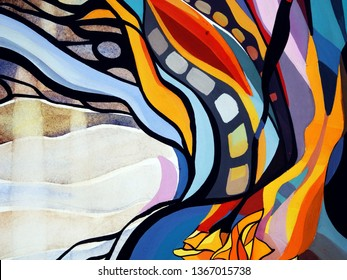 Abstract texture with flowers, yellow roses. Oil, acrylic paints, gouache. Modern painting. Colorful rainbow palette. Avant-garde art. Reminiscent of graffiti. Contemporary art. Stains, spray paint