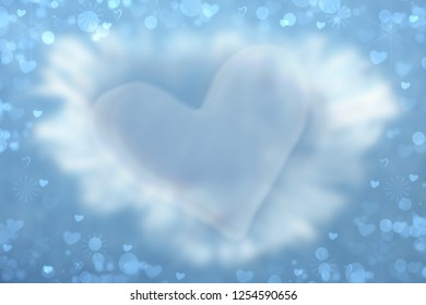 Abstract valentine background. Abtract festive blur bright blue background with a large blue heart for valentine or wedding. Romantic textured backdrop with space for your design. Card concept.