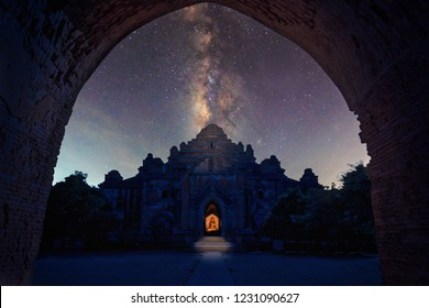 Abstract vintage tone long exposure photography of Ancient Dhammayangyi temple in Bagan, Myanmar in the night time with milky way and stars on the night sky background.